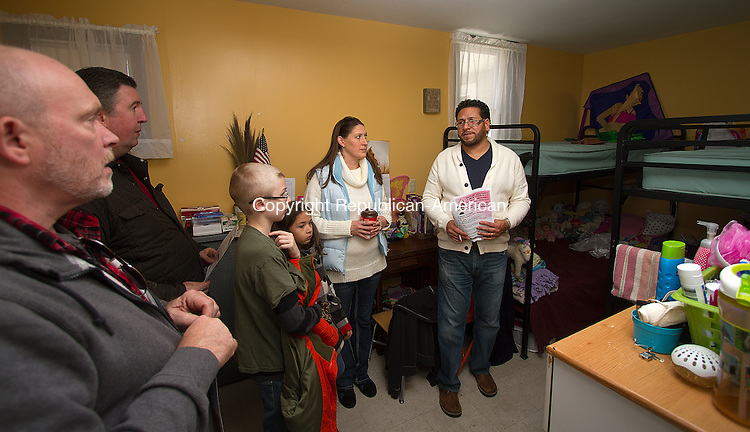 TORRINGTON, CT - 21 NOVEMBER 2015 -112115JW03.jpg -- Prime Time House Rehabilitation Counselor Clark Bellmay, and the family of Bob Wainman, Trey Wainman age 11, Abbygail Berrios age 8 and Lori Walling listen as Micheal Munoz, Homeless Outreach Manager with the Center for Human Development, talks about the issues and needs of those seeking a living space at FISH NWCT during an open house Saturday morning.  Jonathan Wilcox Republican-American