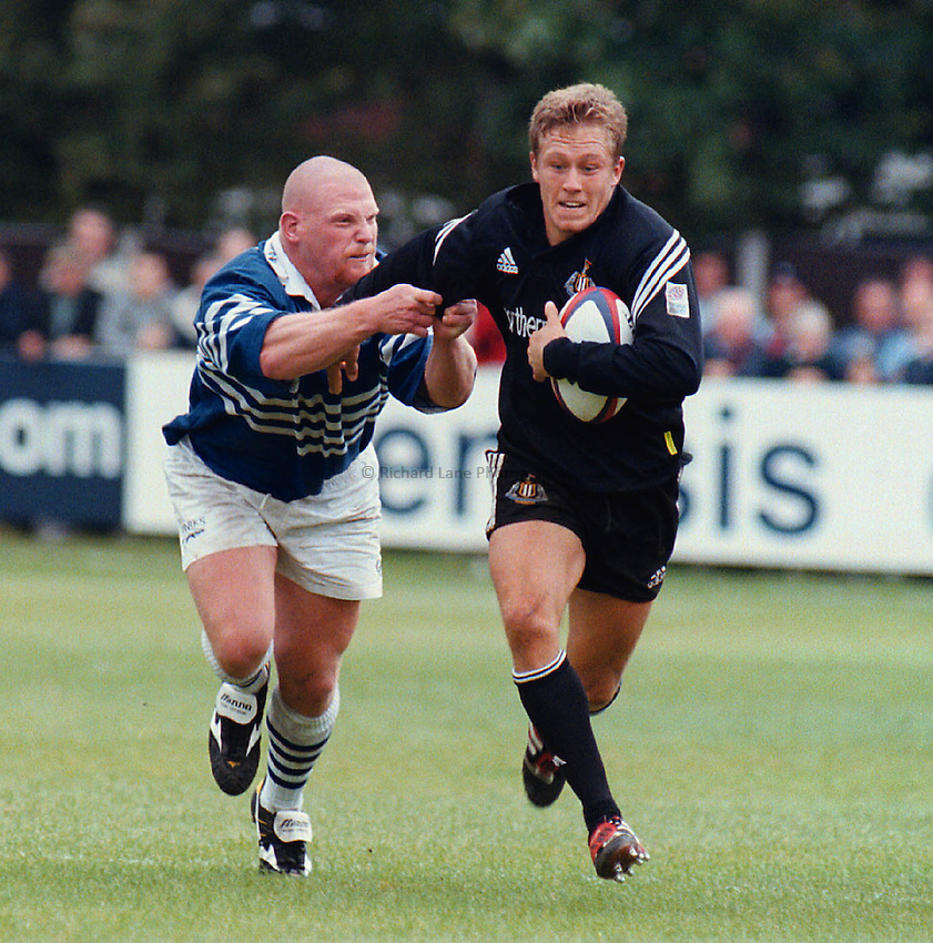 Photo Phil Cash .2.9.2000 Sale v Newcastle .Newcastle fly half Jonny Wilkinson tries to break away from prop Jon Thiel