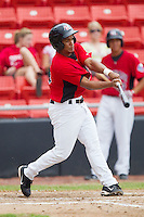 Yefry Castillo #12 of the Hickory Crawdads follows through on his swing against the Kannapolis Intimidators at  L.P. Frans Stadium August 1, 2010, in Hickory, North Carolina.  Photo by Brian Westerholt / Four Seam Images