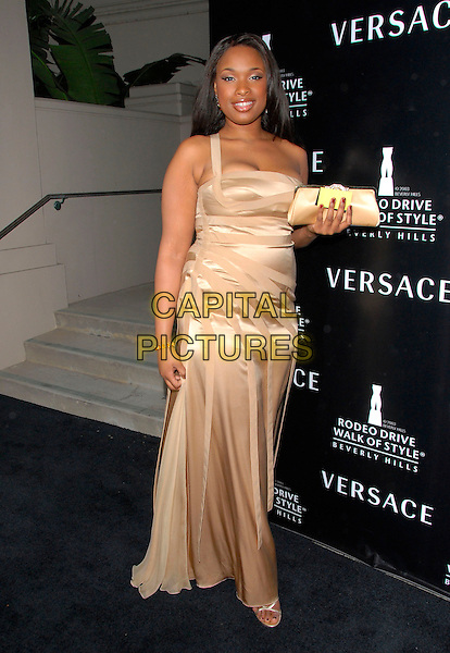 JENNIFER HUDSON.Attends The Rodeo Drive Walk Of Style Award honoring Gianni and Donatella Versace held at The Beverly Hills City Hall in Beverly Hills, California, USA,.February 08 2007..full length gold beige one shoulder starp dress silk satin clutch bag .CAP/DVS.©Debbie VanStory/Capital Pictures