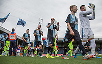 The Teams enter the field during the Sky Bet League 2 match between Wycombe Wanderers and Hartlepool United at Adams Park, High Wycombe, England on 5 September 2015. Photo by Andy Rowland.