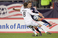 New England Revolution midfielder Chris Tierney (8) brings the ball back after a long dribble down the wing as Toronto FC forward Dan Gargan (8) defends. The New England Revolution defeated Toronto FC, 4-1, at Gillette Stadium on April 10, 2010.