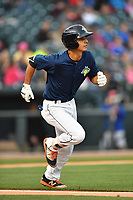Shortstop Andres Jimenez (4) of the Columbia Fireflies runs toward first in a game against the Lakewood BlueClaws on Saturday, May 6, 2017, at Spirit Communications Park in Columbia, South Carolina. Lakewood won, 1-0 with a no-hitter. (Tom Priddy/Four Seam Images)
