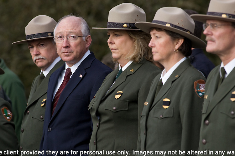 Secretary of the Interior Ken Salazar, second from left, watches the hearse carrying the body of National Park Service Ranger Margaret Anderson during a memorial service at the Pacific Lutheran University for  in Tacoma on January 10, 2010. Anderson, was slain at Mount Rainier on New Years' Day when she set up a road block to intercept a vehicle, driven by Benjamin Barnes, who failed to stop at a chain-up checkpoint.  Barnes, the suspect  in the shooting was found dead was found dead the next day. He had drown in Paradise Creek.