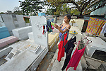 "In the capital of the Philippines, Aramay Calma hangs laundry over tombs in the Manila North Cemetery, where she lives. Hundreds of poor families live here, dwelling in and between the tombs and mausoleums of the city's wealthy. They are often discriminated against, and many of their children don't go to school because they're too hungry to study and they're often called ""vampires"" by their classmates. With support from United Methodist Women, KKFI provides classroom education and meals to kids from the cemetery at a nearby United Methodist Church."