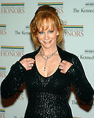 Washington, D.C. - December 2, 2006 -- Reba McEntire arrives for the State Department Dinner for the 29th Kennedy Center Honors dinner at the Department of State in Washington, D.C. on Saturday evening, December 2, 2006.  Andrew Lloyd Webber, Zubin Mehta, Dolly Parton, Smokey Robinson and Stephen Spielberg are being honored in 2006 for their contribution to American culture..Credit: Ron Sachs / CNP