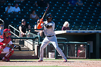 Salt River Rafters center fielder Monte Harrison (4), of the Miami Marlins organization, at bat in front of catcher Jeremy Martinez (4) during an Arizona Fall League game against the Surprise Saguaros on October 9, 2018 at Surprise Stadium in Surprise, Arizona. The Rafters defeated the Saguaros 10-8. (Zachary Lucy/Four Seam Images)