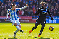 Huddersfield Town's defender Florent Hadergjonaj (33) crosses during the EPL - Premier League match between Huddersfield Town and Crystal Palace at the John Smith's Stadium, Huddersfield, England on 17 March 2018. Photo by Stephen Buckley / PRiME Media Images.