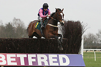 Lord Singer ridden by Joshua Moore by Mr T Weston jumps during the Tim Barclay Memorial Handicap Chase