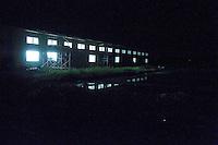 Night view of a commercial building near Route 45 following the 311 Tohoku Tsunami in Motoyoshi, Japan  © LAN