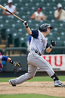 Colorado Springs Sky Sox outfielder Corey Dickerson (23) follows through on his swing against the Round Rock Express in the Pacific Coast League baseball game on May 19, 2013 at the Dell Diamond in Round Rock, Texas. Colorado Springs defeated Round Rock 3-1 in 10 innings. (Andrew Woolley/Four Seam Images).