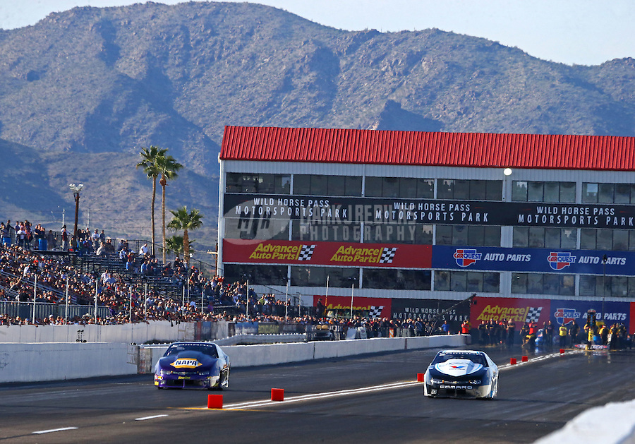 Feb 25, 2017; Chandler, AZ, USA; NHRA pro stock driver Vincent Nobile (left) races alongside Tanner Gray during qualifying for the Arizona Nationals at Wild Horse Pass Motorsports Park. Mandatory Credit: Mark J. Rebilas-USA TODAY Sports
