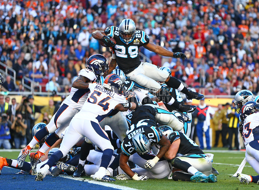Feb 7, 2016; Santa Clara, CA, USA; Carolina Panthers running back Jonathan Stewart (28) dives over the pile of defenders for a touchdown against the Denver Broncos in the second quarter in Super Bowl 50 at Levi's Stadium. Mandatory Credit: Mark J. Rebilas-USA TODAY Sports