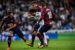 Marcelo Vieira Da Silva (c) of Real Madrid fights for the ball with David Rodriguez Lomban (l), Cristian Rivera Hernandez (2nd r) and Anaitz Arbilla Zabala (r) of SD Eibar during the La Liga 2017-18 match between Real Madrid and SD Eibar at Estadio Santiago Bernabeu on 22 October 2017 in Madrid, Spain. Photo by Diego Gonzalez / Power Sport Images