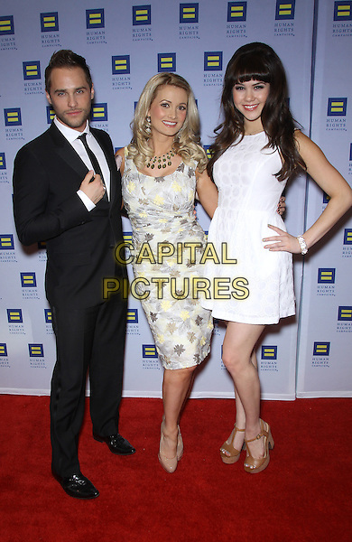 Holly Madison, Josh Strickland, Claire Sinclair.Las Vegas Celebrities celebrate equal love at the 8th Annual Human Rights Campaign Dinner Gala at Aria Las Vegas, Las Vegas, Nevada, USA, 18th May 2013..full length white dress hand on hip  grey gray yellow print suit tie black .CAP/ADM/MJT.© MJT/AdMedia/Capital Pictures