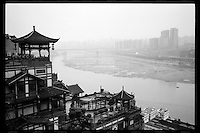 A general view of new and old buildings along Jialing River of Chongqing, China's southwestern municipality, in April, 2011.