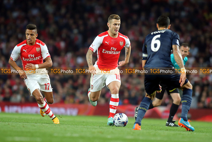 Jack Wilshere of Arsenal takes on Southampton's Jose Fonte - Arsenal vs Southampton - Capital One Cup Third Round Football at the Emirates Stadium, London - 23/09/14 - MANDATORY CREDIT: Paul Dennis/TGSPHOTO - Self billing applies where appropriate - contact@tgsphoto.co.uk - NO UNPAID USE