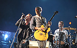 PASADENA, CA. - October 25: Bono, Adam Clayton and Larry Mullen, Jr. of U2 perform in concert during their 360º Tour at the Rose Bowl on October 25, 2009 in Pasadena, California.