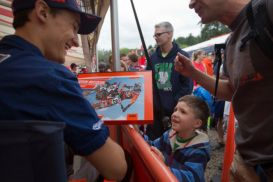 Motocross rider Marvin Musquin gives an autograph to 7 year old Lucas Castro at the Washougal MX National in Washougal Saturday July 23, 2016. D(Photo by Natalie Behring/ for the The Columbian)