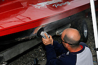 R. J. West goes to work repairing the damage to Shaun Torrente's boat.   (Formula 1/F1/Champ class)