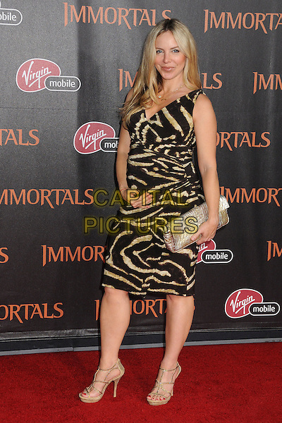 "Shirly Brener.""Immortals"" World Premiere held at Nokia Theatre LA Live, Los Angeles, California, USA..November 7th, 2011.full length black beige print one shoulder dress pregnant gold clutch bag.CAP/ADM/BP.©Byron Purvis/AdMedia/Capital Pictures."
