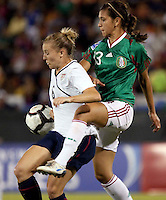 Amy Rodriguez of USA (L) during the semifinal match of CONCACAF Women's World Cup Qualifying tournament held at Estadio Quintana Roo in Cancun, Mexico. Mexico 2, USA 1.