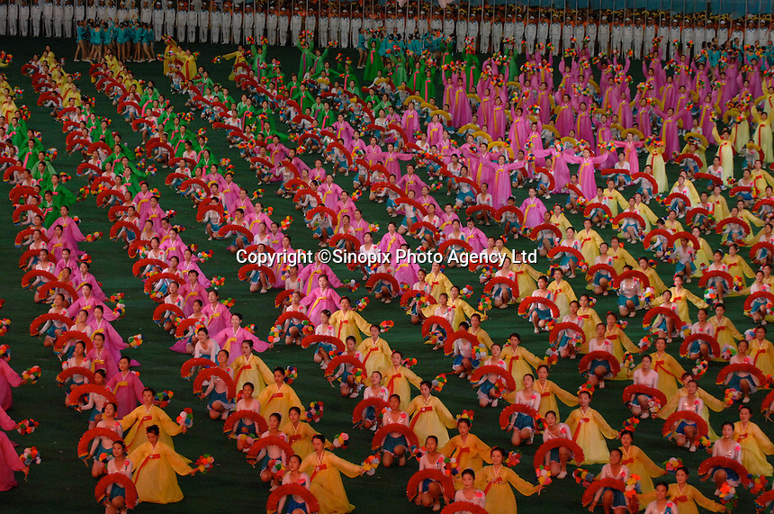 "The Arirang Games in PyongYang, North Korea. Over 100,000 perform. The Mass Games are government-organized events glorifying its two leaders of the DPRK (Democratic People's Republic of Korea) ""Dear Leader"", Kim Jong-il and his father the ""Great Leader"" Kim II-Sung."