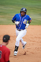 Biloxi Shuckers third baseman Brandon Macias (27) runs the bases after hitting a home run during a game against the Birmingham Barons on May 24, 2015 at Joe Davis Stadium in Huntsville, Alabama.  Birmingham defeated Biloxi 6-4 as the Shuckers are playing all games on the road, or neutral sites like their former home in Huntsville, until the teams new stadium is completed in early June.  (Mike Janes/Four Seam Images)