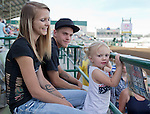 Courtney Farnsworth, three-year-old daughter Alana and Brandon Miller enjoy the Reno Rodeo on Saturday, June 20, 2015.