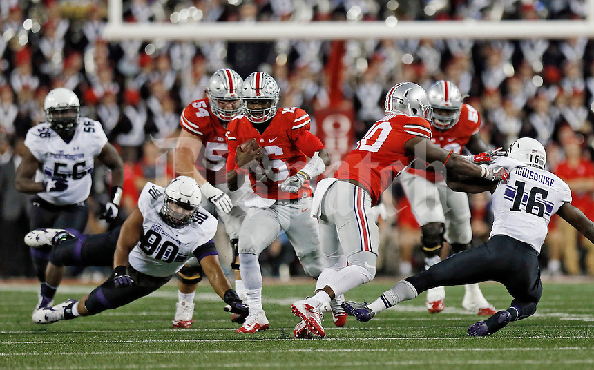 Ohio State Buckeyes wide receiver Noah Brown (80) blocks Northwestern Wildcats safety Godwin Igwebuike (16) to open a lane for quarterback J.T. Barrett (16) to run through during a long run that sealed the win for the Buckeyes during the 4th quarter their game at Ohio Stadium in Columbus, Ohio on October 29, 2016.  (Kyle Robertson / The Columbus Dispatch)