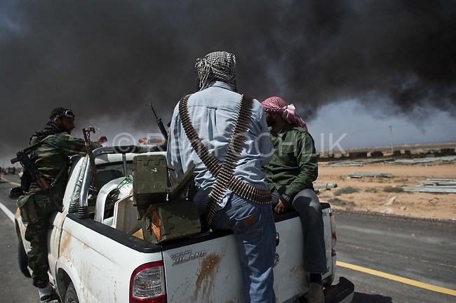© Remi OCHLIK/IP3 - Bin Jawwad March 28, 2011 BIN JAWWAD, Libya -- Rebel forces bore down Monday on Moammar Gadhafi's hometown of Sirte, a key government stronghold where a brigade headed by one of the Libyan leader's sons was digging in to defend the city and setting the stage for a bloody and possibly decisive battle. The opposition made new headway in its rapid advance westward through oil towns and along stretches of empty desert highway toward Sirte and beyond to the big prize -- the capital, Tripoli. Rebels attack had been stopped 50 kilos from Syrte