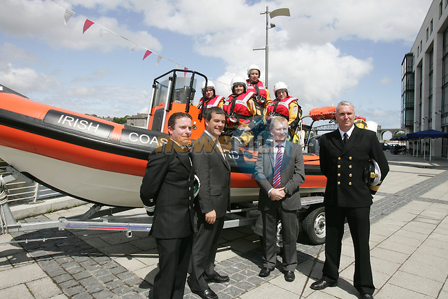 Minister for Transport Noel Dempsey T.D. handing over a new 6m rescue rib to members of the Drogheda unit of the Irish coast Guard at Scotch Hall in Drogheda. The new rib will enable the rescue ares covered by the Drogheda unit to be extended to the Mouth of Carlingford lough to Skerries, the boat will also cover compliance monatering..Pictured are DOIC Andy O'Brien, Christine Osborne, Stephen Geraghty and Colum Watts, Front Minister Dempsey, Dermot McConnoran officer in charge and Dave McMyler VS&T Manager Irish Coast Guard..Photo: Fran Caffrey/www.newsfile.ie...