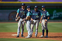 (L-R) Lynchburg Hillcats infielders Nolan Jones (10), Tyler Friis (8), Jonathan Laureano (23), and Tyler Freeman (2) huddle during a pitching change against the Winston-Salem Rayados at BB&T Ballpark on June 23, 2019 in Winston-Salem, North Carolina. The Hillcats defeated the Rayados 12-9 in 11 innings. (Brian Westerholt/Four Seam Images)