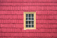 Colorful shingle facade and window.