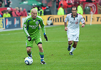 25 April 2010:   Seattle Sounders midfielder Freddie Ljungberg #10 takes the ball up field as Toronto FC midfielder Nick LaBrocca #21gives chase during a game between the Seattle Sounders and Toronto FC at BMO Field in Toronto..Toronto FC won 2-0....