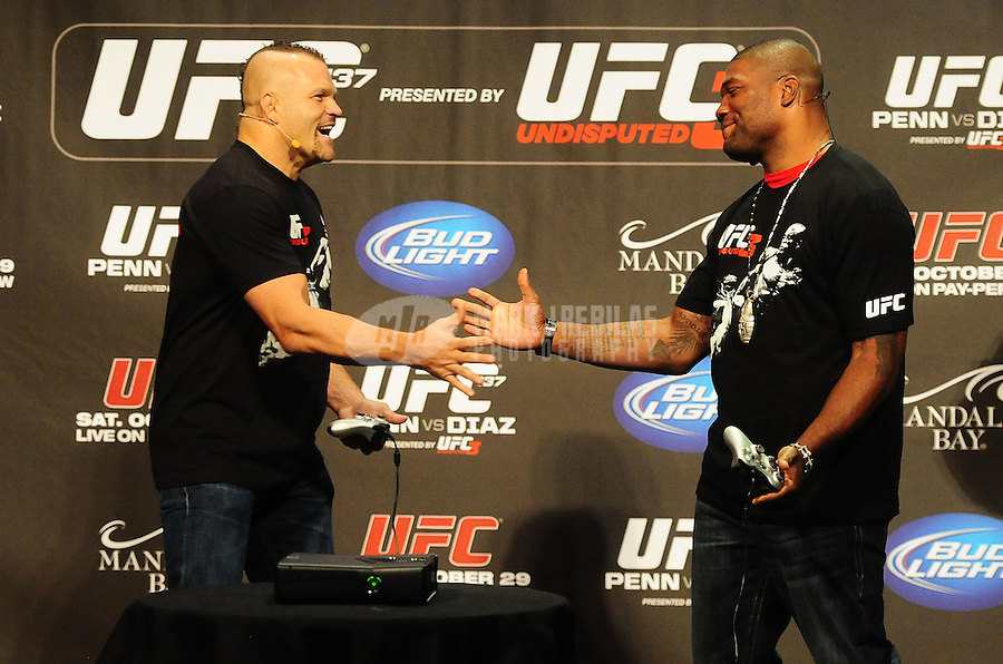 Oct. 28, 2011; Las Vegas, NV, USA; UFC    fighter Chuck Liddell (left) and Quinton Jackson during weigh ins for UFC 137 at the Mandalay Bay event center. Mandatory Credit: Mark J. Rebilas-