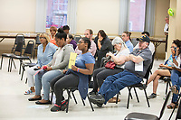 People listen as Ayanna Pressley speaks at an event put on by Chelsea Black Community at the Chelsea Senior Center in Chelsea, Massachusetts, USA, on Wed., June 27, 2018. Pressley is running in the Democratic primary Massachusetts 7th Congressional District against incumbent Mike Capuano. Pressley is currently serving as a member of the Boston City Council, and is the first woman of color elected to the Council.