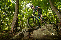 NWA Democrat-Gazette/BEN GOFF @NWABENGOFF<br /> Maxwell Sawyer from Phat Tire Bike Shop in Bentonville models mountain bike clothing and accessories Monday, July 17, 2017, at the Slaughter Pen trails in Bentonville.