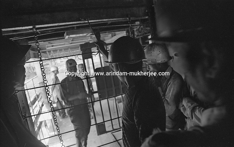 Miners going inside a deep underground mine. Jharkhand, India. Arindam Mukherjee