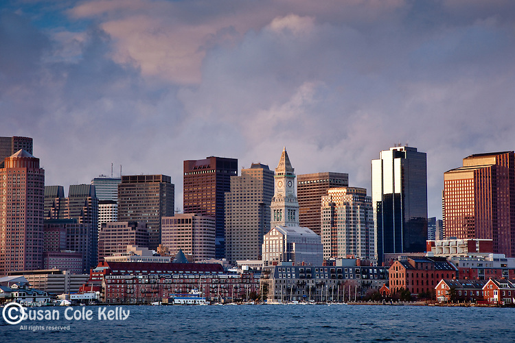A winter sunrise on the skyline of Boston harbor, Boston, MA, USA