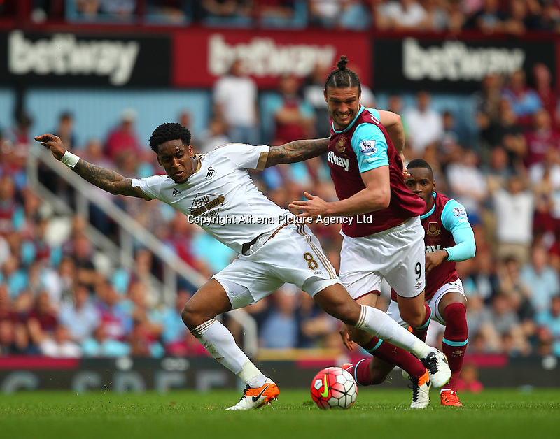 Leroy Fer of Swansea battles with Andy Carroll of West Ham United   during the Barclays Premier League match between West Ham United and Swansea City  played at Boleyn Ground , London on 7th May 2016