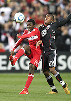 Rodney Wallace #22 of D.C. United pushes up against Patrick Nyarko #14 of the Chicago Fire during an MLS match on April 17 2010, at RFK Stadium in Washington D.C. Fire won the match 2-0.