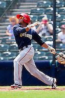 Josh Johnson #15 of the Harrisburg Senators follows through on his swing against the Richmond Flying Squirrels at The Diamond on July 22, 2011 in Richmond, Virginia.  The Squirrels defeated the Senators 5-1.   (Brian Westerholt / Four Seam Images)