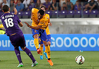 Calcio: amichevole Fiorentina vs Barcellona. Firenze, stadio Artemio Franchi, 2 agosto 2015.<br /> FC Barcelona's Pedro Rodriguez kicks the ball as he is challenged by Fiorentina's Mario Suarez, left, during the friendly match between Fiorentina and FC Barcelona at Florence's Artemio Franchi stadium, 2 August 2015.<br /> UPDATE IMAGES PRESS/Riccardo De Luca