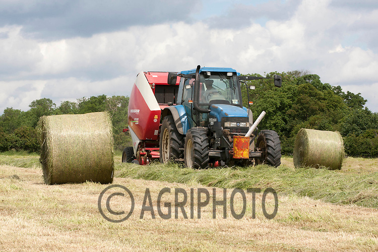 Baling silage to for Winter feed for suckler cows at Croft Far,Uffington,Stamford,Lincolnshire..Picture Tim Scrivener date taken 10th June 2012.Mobile 07850 303986 e-mail tim@agriphoto.com.?.covering agriculture in the Uk?.