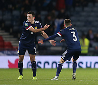 19th November 2019; Hampden Park, Glasgow, Scotland; European Championships 2020 Qualifier, Scotland versus Kazakhstan; John McGinn of Scotland celebrates with Greg Taylor of Scotland after he brings Scotland level in the 48th minute making it 1-1 - Editorial Use