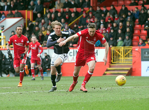 17th March 2018, Pittodrie Stadium, Aberdeen, Scotland; Scottish Premier League football, Aberdeen versus Dundee; Andrew Considine of Aberdeen beaten by Mark O'Hara of Dundee