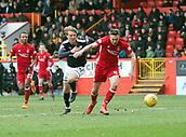 17th March 2018, Pittodrie Stadium, Aberdeen, Scotland; Scottish Premier League football, Aberdeen versus Dundee; Andrew Considine of Aberdeen beaten by Mark O'Hara of Dundee
