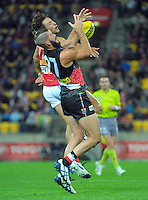 Marco Paparone and Josh Bruce compete for the ball during the Australian Rules Football ANZAC Day match between St Kilda Saints and Brisbane Lions at Westpac Stadium, Wellington, New Zealand on Friday, 25 April 2014. Photo: Dave Lintott / lintottphoto.co.nz