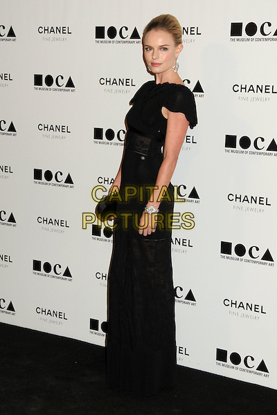 "KATE BOSWORTH .attending MOCA's Annual Gala, ""The Artist's Museum Happening"", Sponsored by Chanel Fine Jewelry, held at MOCA Grand Avenue (Museum Of Contemporary Art) in Los Angeles, California, USA, November 13th 2010. .full length hair up black dress sheer see thru through lace clutch bag long maxi.CAP/ADM/BP.©Byron Purvis/AdMedia/Capital Pictures."